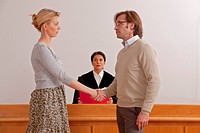 Couple shaking hands in the courtroom