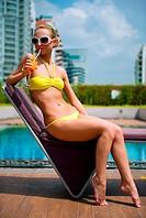 Beautiful girl relaxing in the swimming pool