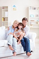 Young parents with her daughter at home