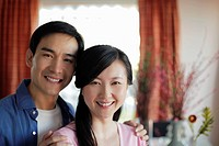 Young couple in their home smiling
