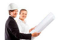 An architect wearing a hard hat and co_worker