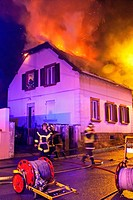 FIREFIGHTERS FIGHTING A HOUSE FIRE AT NIGHT IN THE SUBURBS OF MULHOUSE, HAUT_RHIN 68, FRANCE