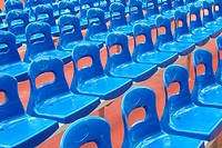 Rows of blue stadium seats