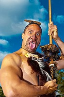A Maori warrior with a ta moko facial tattoo performs a war haka dance, Te Puia New Zealand Maori Arts & Crafts Institute, Rotorua, New Zealand