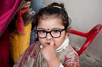 Nursery school - girl dressed up as a teacher picking her nose, Chandigarh, India