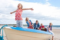 Family in boat on beach