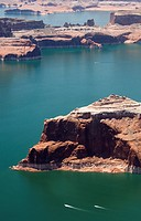 Aerial view of the bathtub ring and a boat in a bend of Lake Powell.