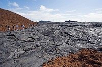 Tourists walking on lava flow on Isla Santiago, Sullivan Bay, Galapagos Islands, UNESCO World Heritage Site, Ecuador, South America