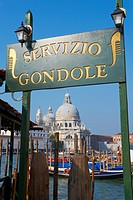 Gondola sign and the Church of Santa Maria della Salute, Venice, UNESCO World Heritage Site, Veneto, Italy, Europe