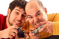 Two young men playing video game console controller