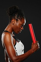 Female Athlete Holding Relay Baton, Focused