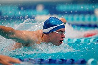 Young Man Swimming Butterfly Stroke