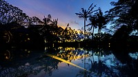 Stunning Sunset over Tropical Swimming Pool