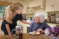 careworker assisting a senior woman in the home