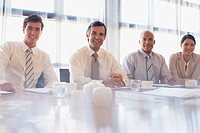 Group of multi_ethnic business people in board room