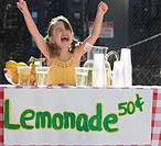 Cheering Caucasian girl operating lemonade stand