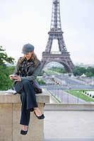 Hispanic woman looking at camera near the Eiffel Tower