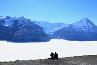 Two People Looking at Mountains