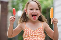 Grinning girl holding popsicle