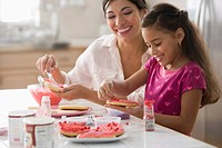 Mother and daughter making Valentine´s cookies