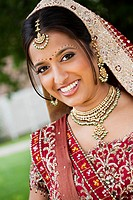 Smiling Indian woman in traditional wedding clothing