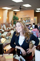 Smiling Hispanic woman in beauty salon