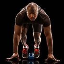 African American runner crouching at starting block
