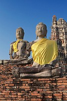 Buddha statues at the ancient ruins of Wat Chaiwatthanaram temple in the city of Ayutthaya, Thailand