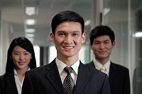 Head shot of three businesspeople in office