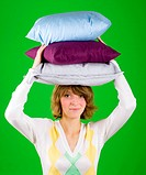 woman with pillows stack