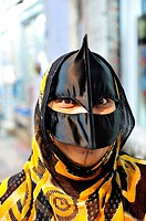 The typical black mask of omani women  Muscat, Oman
