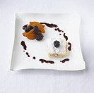 Mont blanc with coffee_poached pear and blackberries with blackberry sauce on white plate, close_up