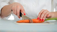 lady cook cutting carrots