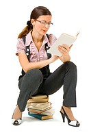 young girl with glasses reading a book