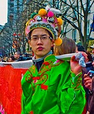 Paris, France, Street Scene, French-Chinese male Teenage Boy in Traditional Costumes Parading in Chinese new years Carnival in Street in the Chinatown...