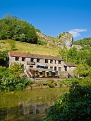 A cottage and tea room overlooking the mill pond at Cheddar Gorge, Somerset, England, United Kingdom