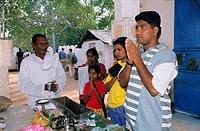 Local family praying and offering, Sri Maha Bodhi, Anuradhapura, Sri Lanka