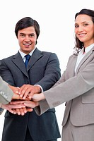 Young businessteam putting hands together against a white background