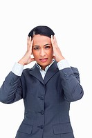 Close up of saleswoman experiencing a headache against a white background