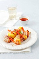 Prawn kebabs with mango and scallops wrapped in bacon