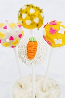 Cake pops decorated for spring hearts, butterflies, carrots