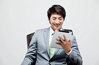 Asian Businessman Working On Digital Tablet
