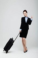Asian Businesswoman Standing With Luggage