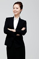 Asian Businesswoman Standing With Arm Crossed