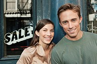 Portrait of couple outside shop