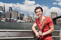 Portrait of man in front of Manhattan skyline, New York City, USA