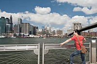 Man looking at Manhattan skyline, New York City, USA