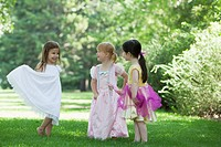 Smiling girls 3_4 dressed up like princess