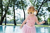 Girl 3-4 wearing costume and sunglasses playing at pool (thumbnail)