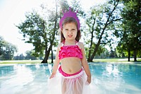 Portrait of girl 3_4 in costume standing near pool